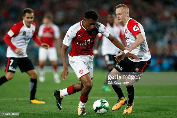 Alex Iwobi of Arsenal evades Jack Clisby of the Wanderers during the match between the Western Sydney Wanderers and Arsenal FC at ANZ Stadium on July...