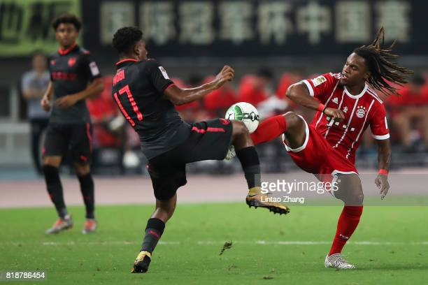 Alex Iwobi of Arsenal FC of Arsenal FC competes for the ball with Renato Sanches of FC Bayern during the 2017 International Champions Cup football...