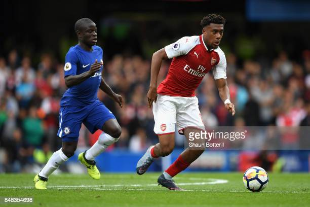 Alex Iwobi of Arsenal gets away from N'Golo Kante of Chelsea during the Premier League match between Chelsea and Arsenal at Stamford Bridge on...
