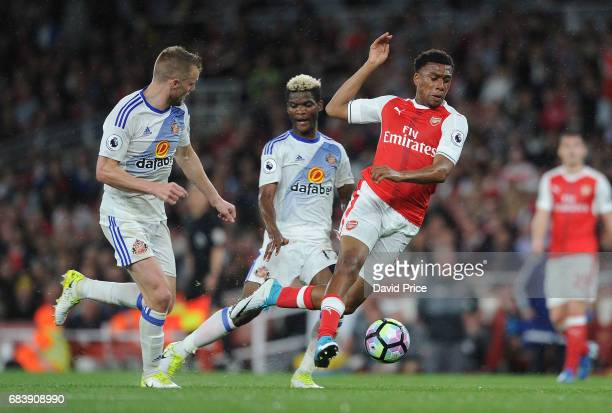 Alex Iwobi of Arsenal is fouled by Didier N'Dong of Sunderland during the Premier League match between Arsenal and Sunderland at Emirates Stadium on...