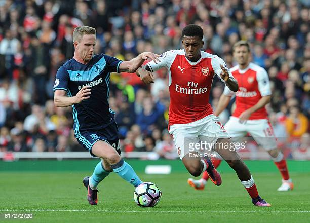 Alex Iwobi of Arsenal takes on Adam Forshaw of Middlesbrough during the Premier League match between Arsenal and Middlesbrough at Emirates Stadium on...