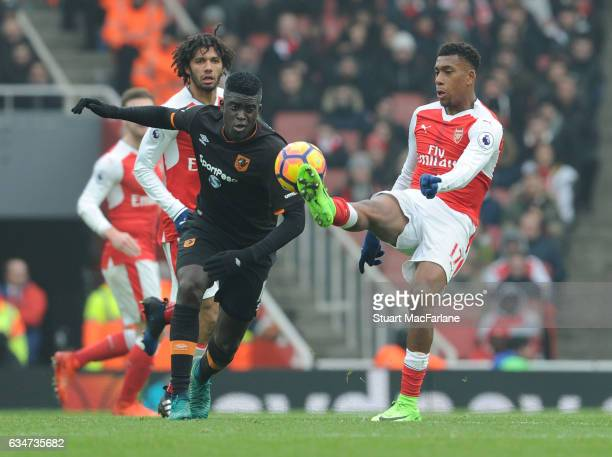 Alex Iwobi of Arsenal takes on Alfred N'Diaye of Hull during the Premier League match between Arsenal and Hull City at Emirates Stadium on February...