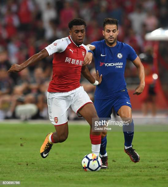 Alex Iwobi of Arsenal takes on Cesc Fabregas of Chelsea during the match between Arsenal and Chelsea at Birds Nest on July 22 2017 in Beijing China