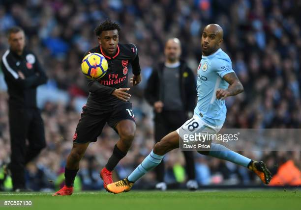 Alex Iwobi of Arsenal takes on Fabian Delph of Man City during the Premier League match between Manchester City and Arsenal at Etihad Stadium on...