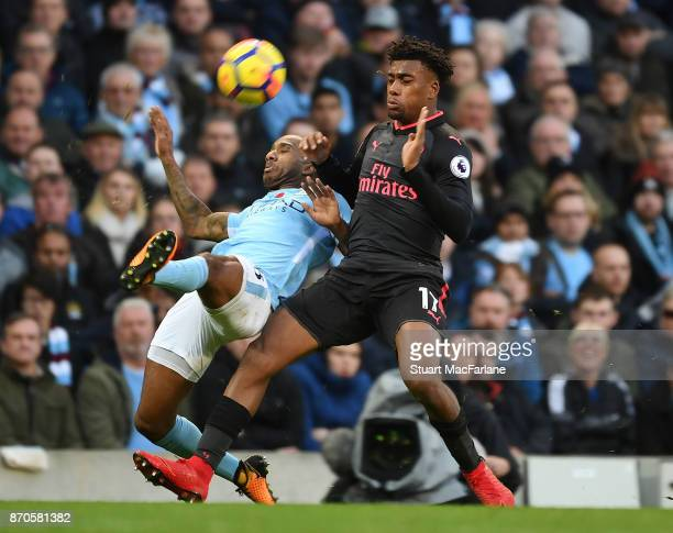 Alex Iwobi of Arsenal takes on Fernandinho of Man City during the Premier League match between Manchester City and Arsenal at Etihad Stadium on...