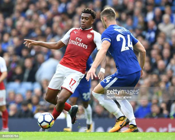 Alex Iwobi of Arsenal takes on Gary Cahill of Chelsea during the Premier League match between Chelsea and Arsenal at Stamford Bridge on September 17...