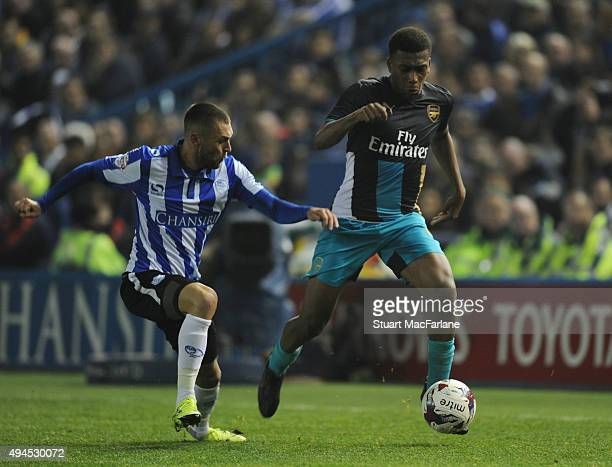 Alex Iwobi of Arsenal takes on Jack Hunt of Sheffield Wednesday during the Capital One Cup Fourth Round match between Sheffield Wednesday and Arsenal...