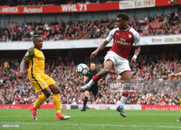 Alex Iwobi of Arsenal takes on Jose Izquierdo of Brighton during the Premier League match between Arsenal and Brighton and Hove Albion at Emirates...