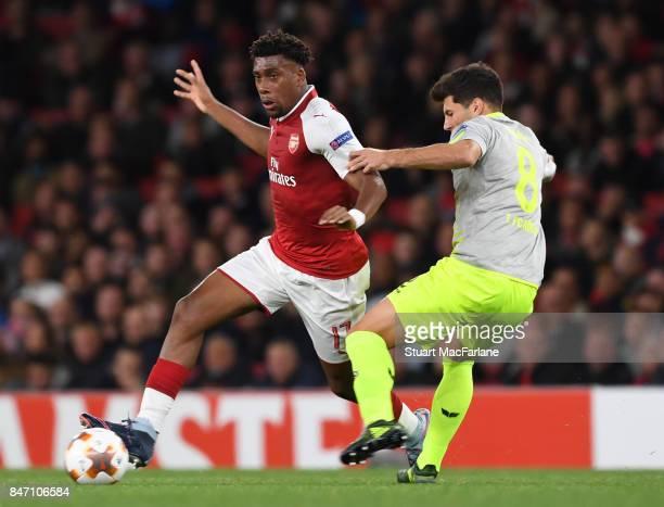 Alex Iwobi of Arsenal takes on Milos Jojic of Koln during the UEFA Europa League group H match between Arsenal FC and 1 FC Koeln at Emirates Stadium...