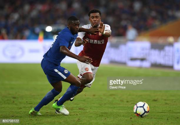 Alex Iwobi of Arsenal takes on Oluwafikayomi Tomori of Chelsea during the match between Arsenal and Chelsea at Birds Nest on July 22 2017 in Beijing...