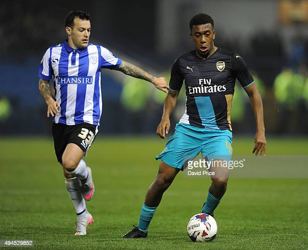 Alex Iwobi of Arsenal takes on Ross Wallace of Sheffield Wednesday during the Capital One Cup 4th Round match between Sheffield Wednesday and Arsenal...