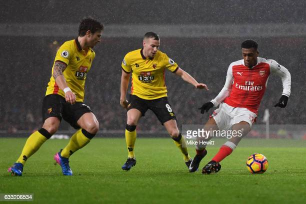 Alex Iwobi of Arsenal takes on Tom Cleverley and Daryl Janmaat of Watford during the Premier League match between Arsenal and Watford at Emirates...