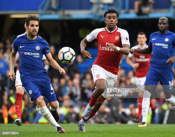 Alex Iwobi of Arsenal under pressure from Cesc Fabregas of Chelsea during the Premier League match between Chelsea and Arsenal at Stamford Bridge on...