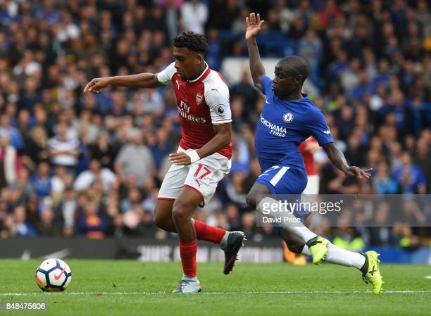 Alex Iwobi of Arsenal under pressure from N'Golo Kante of Chelsea during the Premier League match between Chelsea and Arsenal at Stamford Bridge on...