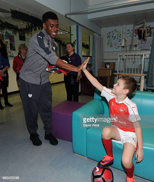 Alex Iwobi of Arsenal visits the patients on the childrens ward at Whittington Hospital on December 22 2016 in London England