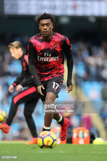 Alex Iwobi of Arsenal warms up prior to the Premier League match between Manchester City and Arsenal at Etihad Stadium on November 5 2017 in...