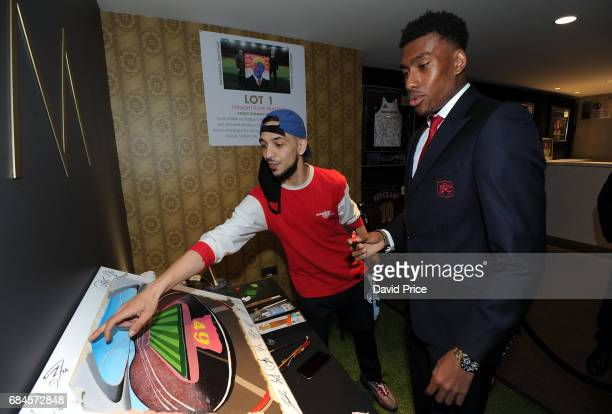 Alex Iwobi of Arsenal with local artist Stazzy at the Arsenal Foundation Charity Ball 'A Night to Inspire' on May 18 2017 in London England