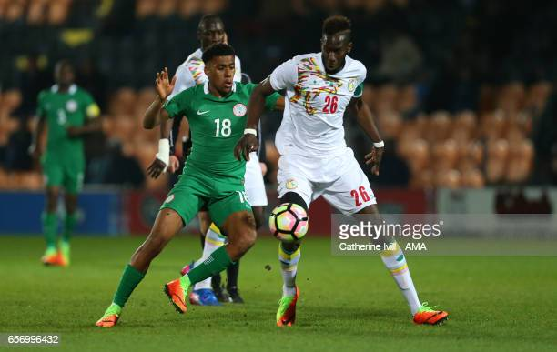 Alex Iwobi of Nigeria and Salif Sane of Senegal during the International Friendly match between Nigeria and Senegal at The Hive on March 23 2017 in...