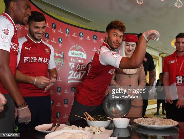 Alex Iwobi Sead Kolasinac and Alex OxladeChamberlain of Arsenal takes part in a chinese cooking event for Emirates on July 21 2017 in Beijing China