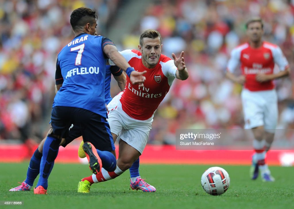 Alex Jack Wilshere of Arsenal takes on Nabil Dirar of AS Monaco during the Emirates Cup match between Arsenal and AS Monaco at Emirates Stadium on August 3, 2014 in London, England.
