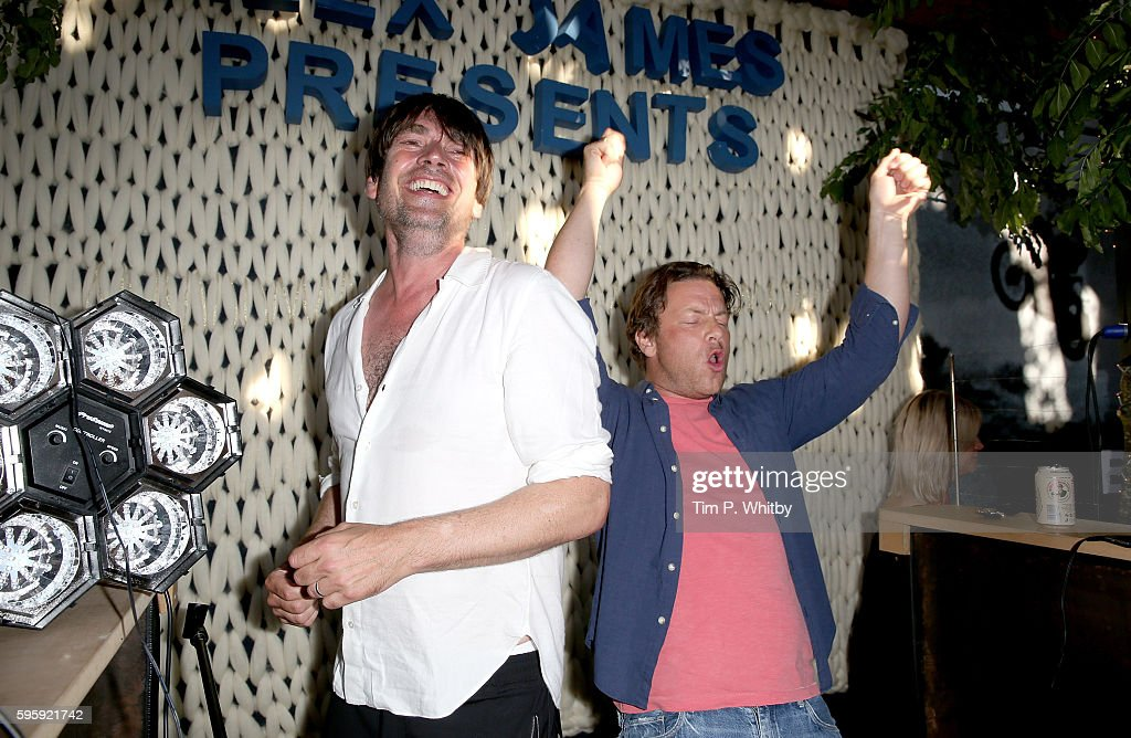 Alex James and Jamie Oliver playing songs at the Cheese Hub on the first day of The Big Feastival at Alex James' Farm on August 26, 2016 in Kingham, Oxfordshire.