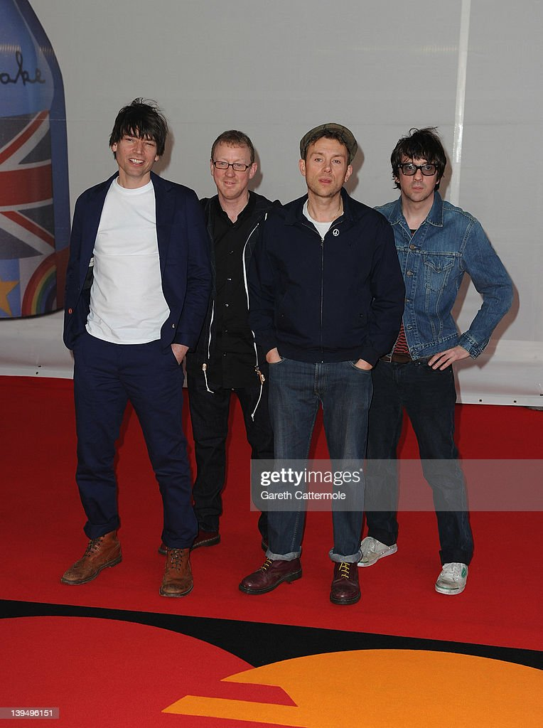 Alex James Dave Rowntree Damon Albarn and Graham Coxon of Blur attend The BRIT Awards 2012 at the O2 Arena on February 21 2012 in London England