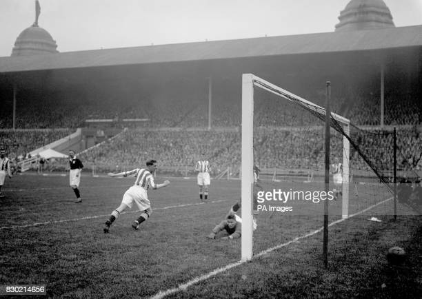 Alex James scores for Arsenal in the first half of the game against Huddersfield at Wembley in the 1930 Cup Final