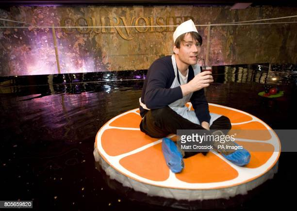 Alex James sits on a raft in a 4000litre Courvoisier punch bowl at the VIP launch of the Courvoisier Architectural Punch Bowl exhibition at 33...
