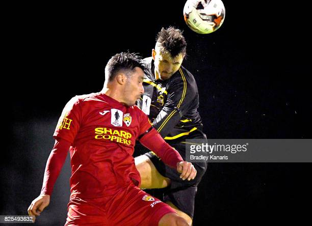 Alex Janovsky of Moreton Bay and Scott Pettit of the Magic challenge for the ball during the FFA Cup round of 32 match between Moreton Bay United FC...