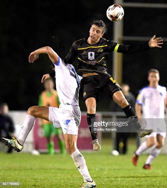 Alex Janovsky of Moreton Bay gets above Jacob Boutoubia of Gold Coast City during the FFA Cup round of 16 match between Moreton Bay United and Gold...