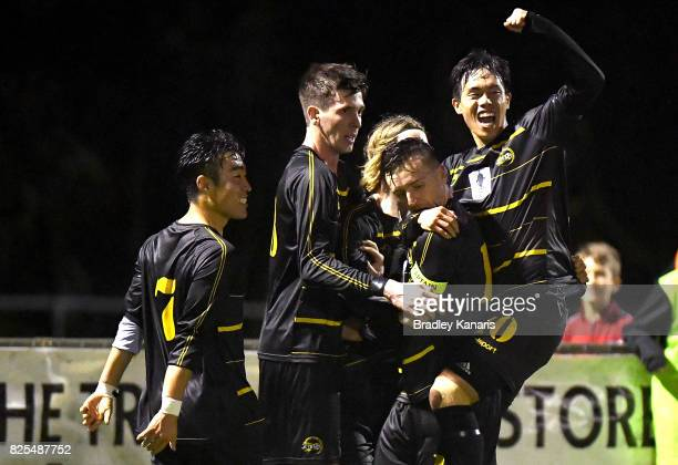 Alex Janovsky of Moreton Bay is congratulated by team mates after scoring a goal during the FFA Cup round of 32 match between Moreton Bay United FC...