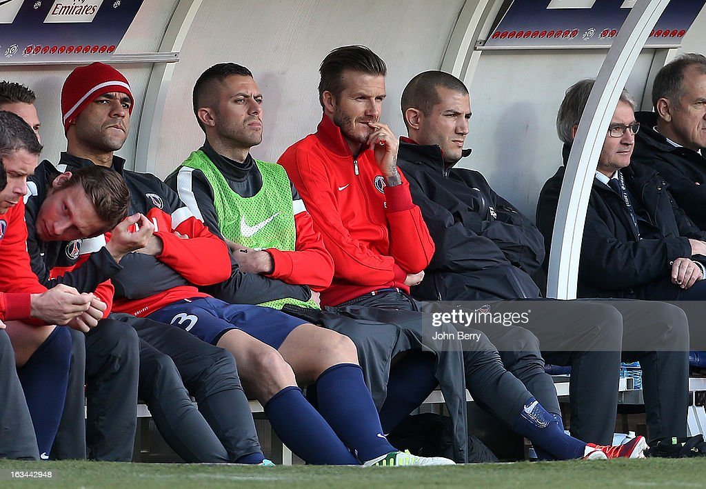 Alex, Jeremy Menez and <a gi-track='captionPersonalityLinkClicked' href=/galleries/search?phrase=David+Beckham&family=editorial&specificpeople=158480 ng-click='$event.stopPropagation()'>David Beckham</a> of PSG sit on the bench during the french Ligue 1 match between Paris Saint-Germain FC and AS Nancy-Lorraine ASNL at the Parc des Princes stadium on March 9, 2013 in Paris, France.