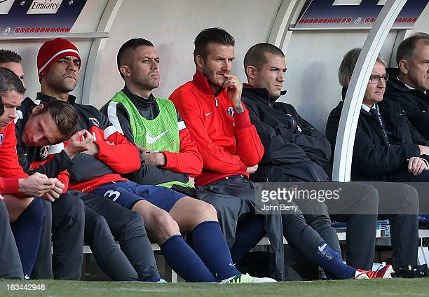 Alex Jeremy Menez and David Beckham of PSG sit on the bench during the french Ligue 1 match between Paris SaintGermain FC and AS NancyLorraine ASNL...