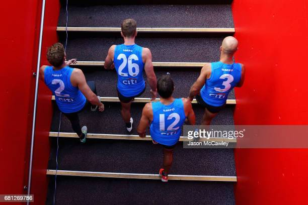 Alex Johnson Luke Parker Josh P Kennedy and Jarrad McVeigh of the Swans take to the field during a Sydney Swans AFL training session at Sydney...