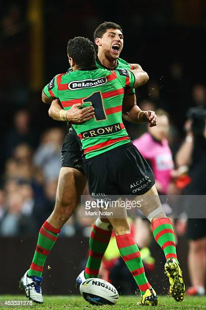 Alex Johnston of the Rabbitohs celebrates scoring a try during the round 22 AFL match between the South Sydney Rabbitohs and the Manly Sea Eagles at...