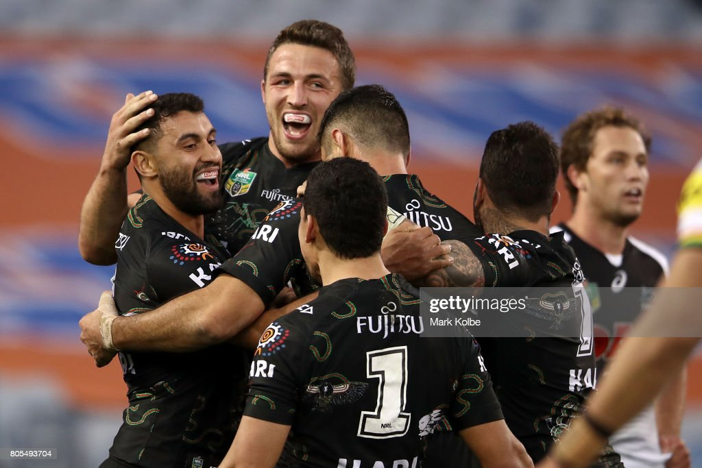 Alex Johnston of the Rabbitohs celebrates with his team mates after scoring a try during the round 17 NRL match between the South Sydney Rabbitohs and the Penrith Panthers at ANZ Stadium on July 2, 2017 in Sydney, Australia.