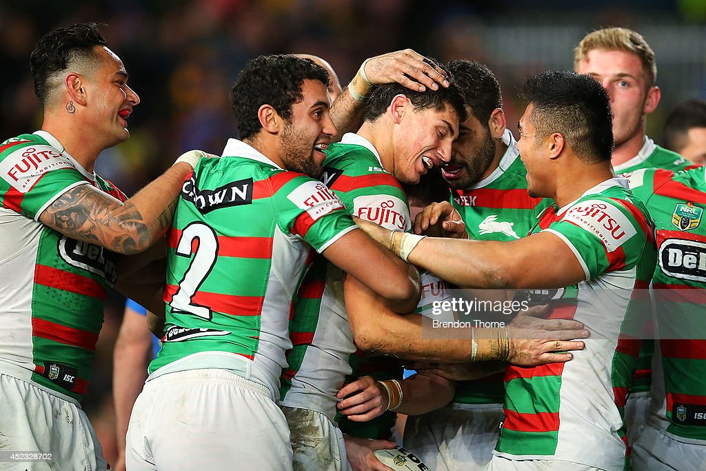 Alex Johnston of the Rabbitohs celebrates with team mates after scoring a try during the round 19 NRL match between the Parramatta Eels and the South Sydney Rabbitohs at Pirtek Stadium on July 18, 2014 in Sydney, Australia.