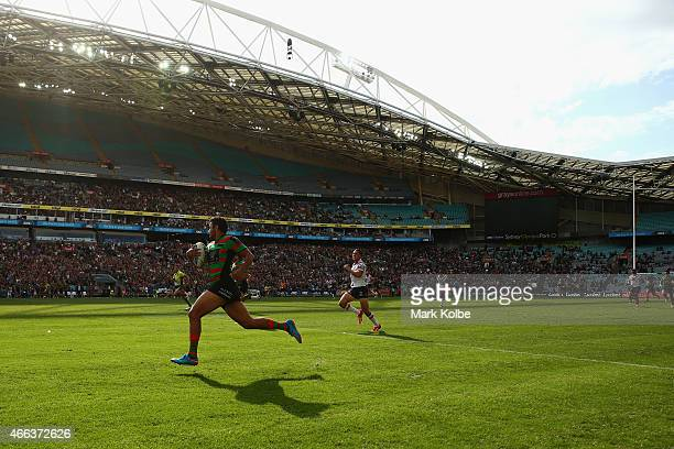 Alex Johnston of the Rabbitohs makes a break on his way to scoring a try during the round two NRL match between South Sydney Rabbitohs and the Sydney...