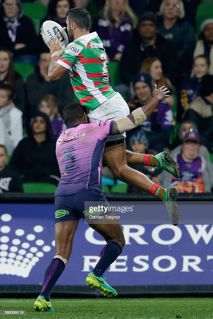 Alex Johnston of the Rabbitohs score a try during the round 22 NRL match between the Melbourne Storm and the South Sydney Rabbitohs at AAMI Park on...