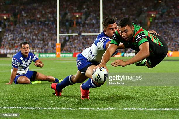 Alex Johnston of the Rabbitohs scores a try during the 2014 NRL Grand Final match between the South Sydney Rabbitohs and the Canterbury Bulldogs at...