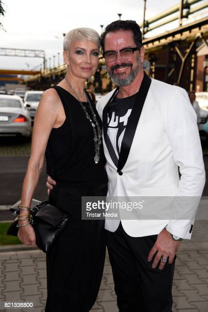 Alex Jolig and his wife Britt JoligHeinz attend the Thomas Rath show during Platform Fashion July 2017 at Areal Boehler on July 23 2017 in...