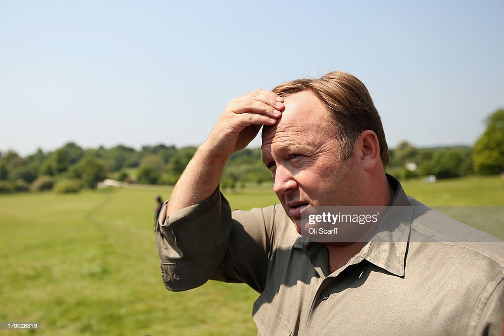 Alex Jones, an American radio host, author and conspiracy theorist, addresses media and protesters in the protester encampment outside The Grove hotel, which is hosting the annual Bilderberg conference, on June 6, 2013 in Watford, England. The traditionally secretive conference, which has taken place since 1954, is expected to be attended by politicians, bank bosses, billionaires, chief executives and European royalty.