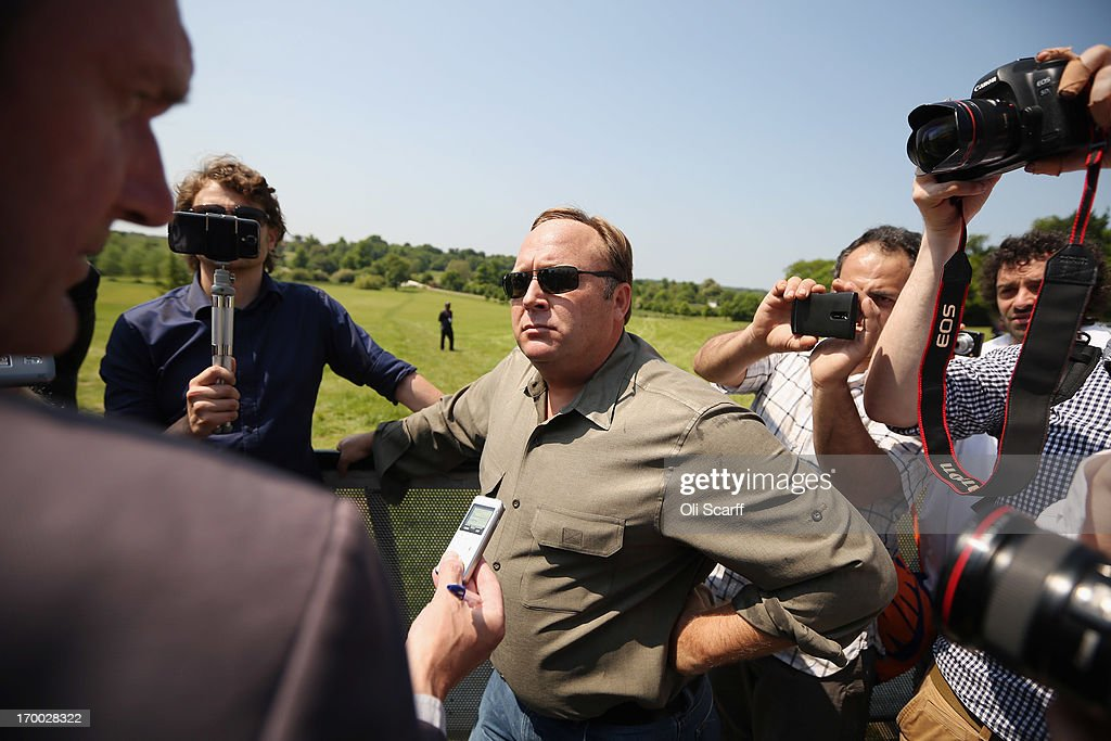 Alex Jones (C), an American radio host, author and conspiracy theorist, addresses media and protesters in the protester encampment outside The Grove hotel, which is hosting the annual Bilderberg conference, on June 6, 2013 in Watford, England. The traditionally secretive conference, which has taken place since 1954, is expected to be attended by politicians, bank bosses, billionaires, chief executives and European royalty.