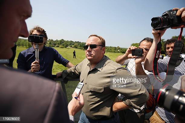 Alex Jones an American radio host author and conspiracy theorist addresses media and protesters in the protester encampment outside The Grove hotel...
