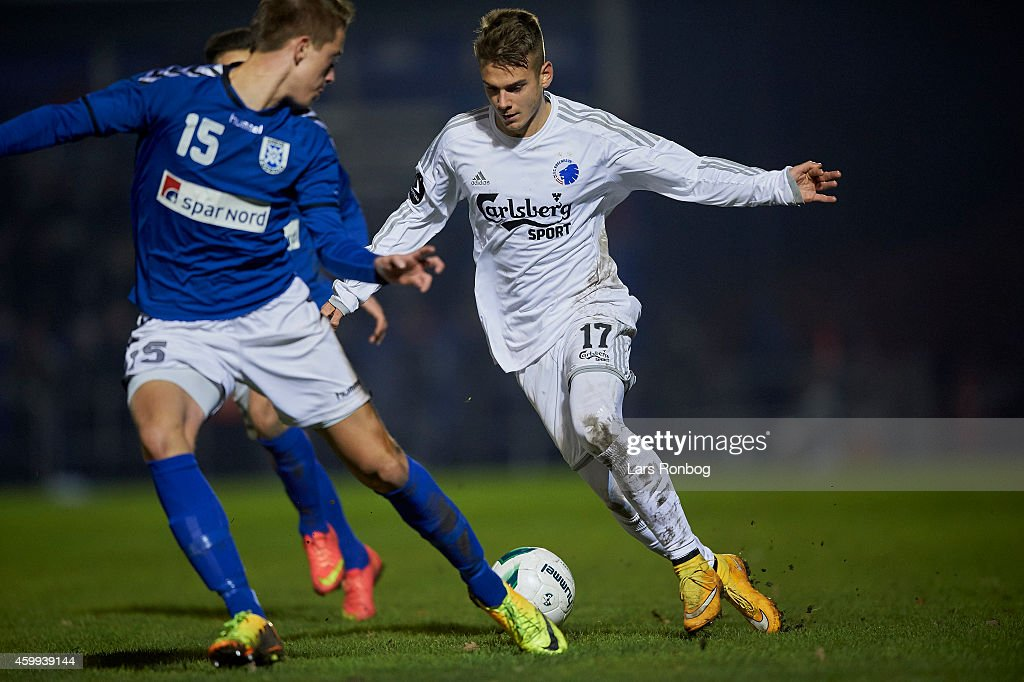 Alex Kacaniklic of FC Copenhagen and Sebastian Frank of Greve Fodbold compete for the ball during the DBU Pokalen Danish Cup match between Greve IF and FC Copenhagen at Greve Stadion on December 4, 2014 in Greve, Denmark.
