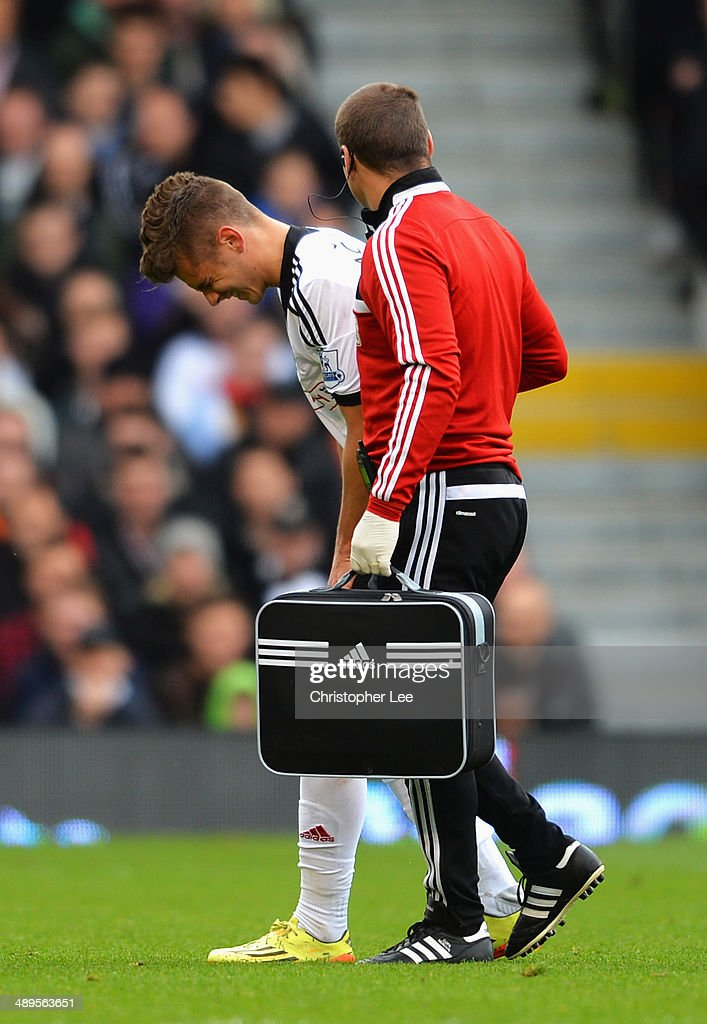 Alex Kacaniklic of Fulham leaves the field injured during the Barclays Premier League match between Fulham and Crystal Palace at Craven Cottage on May 11, 2014 in London, England.