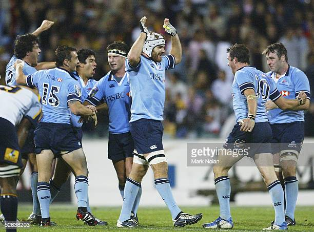 Alex Kanaar of the Waratahs and other Waratahs players celebrate their victory after the Super 12 match between the ACT Brumbies and the NSW Waratahs...