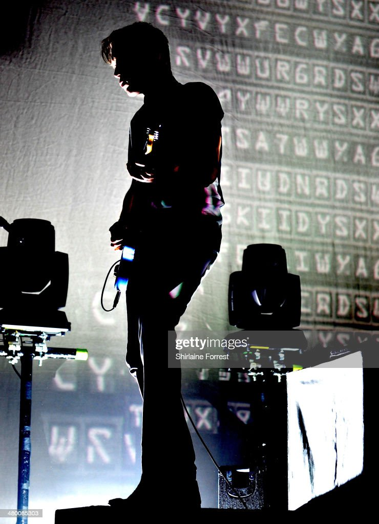 <a gi-track='captionPersonalityLinkClicked' href=/galleries/search?phrase=Alex+Kapranos&family=editorial&specificpeople=206835 ng-click='$event.stopPropagation()'>Alex Kapranos</a> of Franz Ferdinand performs at Manchester Academy on March 22, 2014 in Manchester, England.
