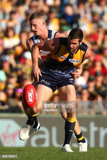 Alex Keath of the Crows and Jack Darling of the Eagles contest for the ball during the round 23 AFL match between the West Coast Eagles and the...