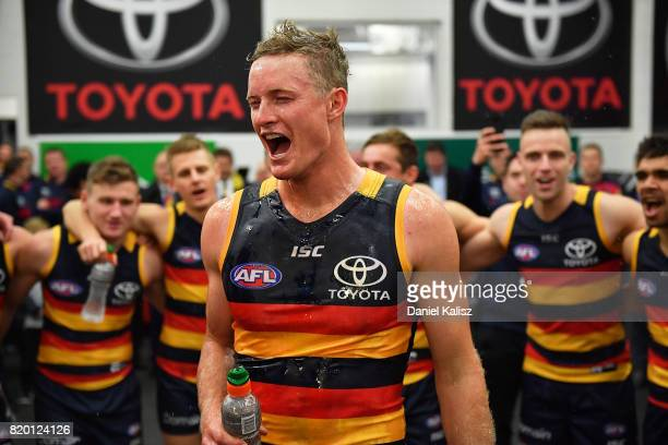 Alex Keath of the Crows singa the club song after the round 18 AFL match between the Adelaide Crows and the Geelong Cats at Adelaide Oval on July 21...